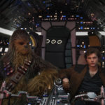 Han Solo and Chewbacca in the cockpit of the Millennium Falcon in Solo: A Star Wars Story